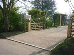 Gravel drive and a five bar gate